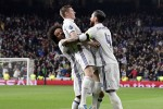 Real Madrid's German midfielder Toni Kroos (C) celebrates a goal with Real Madrid's Brazilian defender Marcelo (L) and Real Madrid's defender Sergio Ramos during the UEFA Champions League round of 16 first leg football match Real Madrid CF vs SSC Napoli at the Santiago Bernabeu stadium in Madrid on February 15, 2017. / AFP / JAVIER SORIANO        (Photo credit should read JAVIER SORIANO/AFP/Getty Images)