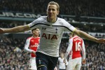 Tottenham's Harry Kane celebrates after scoring during the English Premier League soccer match between Tottenham Hotspur and Arsenal at the White Hart Lane stadium in London, Saturday, Feb. 7, 2015. (AP Photo/Alastair Grant)