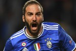 Juventus forward from Argentina Gonzalo Higuain celebrates after scoring a goal during the UEFA Champions League semi-final first leg football match Monaco vs Juventus at the Stade Louis II stadium in Monaco on May 3, 2017.  / AFP PHOTO / FRANCK FIFE        (Photo credit should read FRANCK FIFE/AFP/Getty Images)